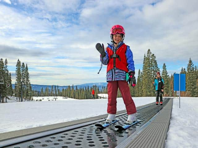 Ski School kids riding the magic carpet on opening day up at Brundage Ski Resort