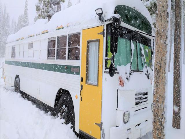 To not be effected by ski town housing crisis is to bring your own house.  Like this ski bum school bus!